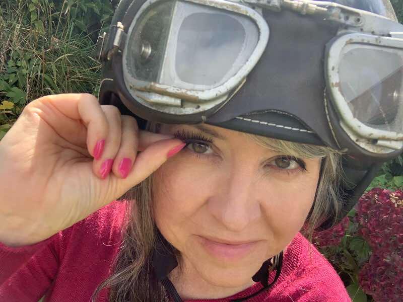 false eyelashes in a motorcycle helmet